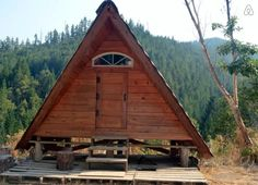 """Check out this awesome listing on Airbnb: """"A-Frame"""" Rustic Off-Grid Cabin - Cabins for Rent in Gasquet A Frame Cabin, A Frame House, Open Living Area, Small Living, Cabana, Emerson, Wooden House Design, Off Grid Cabin, Renting A House"""