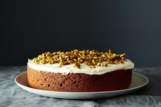 Pumpkin cake with cream cheese frosting & caramelized pumpkin seeds Food 52