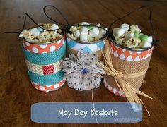 DIY May Day Baskets: Looking for a homemade May Day Basket idea? Check your recycling bin for basket items. We made these using soup cans and scrap paper, buttons and twine. My Creative Days