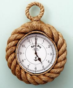 Know Your Ropes Wall Clock: A journey to the Mediterranean. A seafaring adventure taking leave from a faraway port. A summer passed along the shore, where sails of white float as effortlessly as clouds in the sky. Recall the allure of the sea with the Know Your Ropes Wall Clock. Composed of natural jute, the clock bestows an understated nautical feel to your mudroom, reading alcove, or guest cottage.