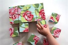 create simple puzzles by gluing printed fabric on wooden blocks. each side of the blocks can have a different image to solve. the different patterns can go from very simple to very complex. make sure each image is a radically different colour from other sides of the blocks, to avoid confusion.
