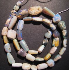 Beautiful strand of Australian Lightning Ridge Opal Beads - available in our store :)