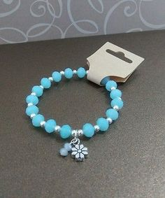 Sky blue faceted rondels stretch bracelet with silver plated findings.