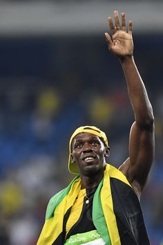 Jamaica's Usain Bolt celebrates after he won the Men's 100m Final during the…