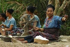 """Traditional Cotton Spinning in Flores - Indonesia. The picture was taken in Watublapi - a village about 18 km south east of Maumere. Bliransina Ikat weavers co-operative in Watublapi keep the tradition alive. The visitors may learn the complete Ikat Weaving process from spinning the cotton to """"Ikat"""" and then weave traditional sarongs. by Ng Sebastian"""