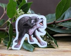 Grey Terrier Mix Dog on Weatherproof Glossy Sticker Paper Height: Inches; Width: Inches Stickers are sold individually or in packs of 3 and 10 Product specs: Terrier Mix Dogs, Mixed Breed, Glossier Stickers, Lion Sculpture, Statue, Black And White, Creative, Prints, Handmade