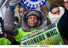 CHICAGO, ILLINOIS - NOVEMBER 28, 2014: Striking Walmart workers and supporters protest against low wages and charge that Walmart retaliates against employees who push for better working conditions. - stock photo