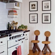 A pair of 1950s rope-and-wood chairs from Harbinger gives a playful vibe to the otherwise all-white kitchen. | Coastalliving.com