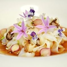 Gently Poached South Australian Squid, Garlic Custard, Baby Radishes, Native Violets, Roasted Squid Broth of Quay Restaurant
