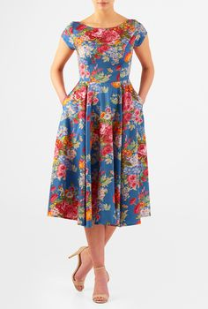 An elegant wide boat neck tops our fit-and-flare cotton sateen  dress featuring floral print all over.