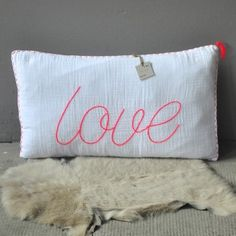 numero 74. Add detail to a pillow in pink! and some extra fringe in pink