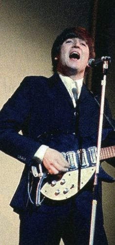 John Lennon.....SINGING HIS LITTLE [BIG] HEART OUT......I LOVE THIS PICTURE...JOHN I MISS YOU.... WISH YOU WERE HERE.....LOVE..R.I.P.