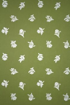 1950s Vintage Wallpaper. Vintage fifties wallpaper with a small white flower pattern on a green colored background. 1950s (Vintage Wallpaper)
