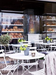United Bakeries | Oslo, Norway. Love the outside seating and dark features!