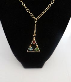 The Legend of Zelda Inspired Golden Choker with Hanging Triforce and Spiritual Stones on Etsy, $60.00