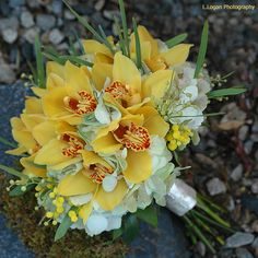 yellow wedding flowers | Yellow and white wedding bouquet idea with yellow orchids.