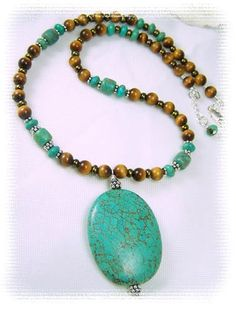"""7x7mm and 6x3mm Turquoise Gemstones, 6mm Tigers Eye Gemstones, Copper glass seed beads and Sterling Silver beads. pendant measure 2"""" x 1 1/2"""".  17 - 17 3/4"""""""