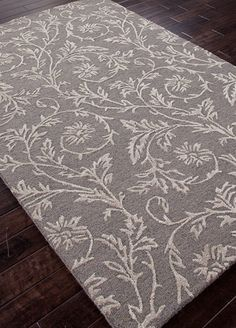 A transitional range of rugs inspired by more traditional motifs hand tufted in wool and art silk. The look is very elegant and is  offered in a range of tonal color combinations that are easy to use in any room setting. Each rugs feels and looks luxuriou