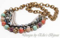 A multi strand necklace featuring Paua Shell and a mix of unique beads