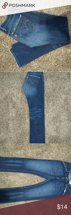 Ladies Denim Levi Jeans Durable Dark and Light colored Levi Jeans size 11M. Pant legs are straight leg. Levi's Jeans Straight Leg