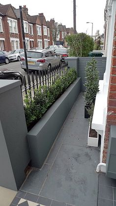 Grey walls metal rail tile planting design modern formal Balham Clapham Wandsworth Londob Source by finnerswalton