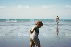 'Childhood' Preschool Child playing on the Beach in Summer with Father in the Distance. Royalty-Free Stockphoto available. See my Portfolio for more. Men Beach, Commercial Art, Beach Photos, Pre School, Image Now, Fine Art Photography, Kids Playing, Royalty Free Stock Photos, Children