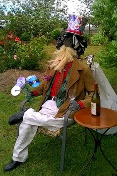 """A recycled everything scarecrow.  Bob the Scarecrow,  by Joanne & Jennifer Holloway,  """"Drinking in the View"""" at an Open Garden in Sheffield,  Tasmania."""