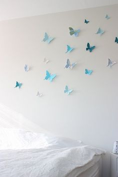 love this for maybe a baby room? some of the butterflies are cut from maps.