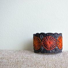Embroidered felt cuff