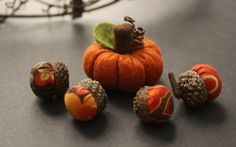 felted pumpkin and fabric acorns