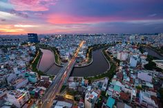 #advertiseattractionbuildingcityscapecurvedaydisplaydowntownhistorylandmarklocmarketmerchandisenightnightscapeoldoutdoorretailroofsouthsouvenirstreettowntraffictravelurbannhieu #JangNhut (November 3 2015 at 01:40PM) HO CHI MINH CITY VIETNAM - OCTOBER 17 2015: Aerial sunset view of houses and Business and Administrative Center of Ho Chi Minh city on NHIEU LOC canal