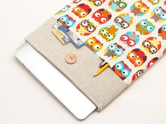 LINEN MACBOOK CASE WITH OWLS POCKET AND WOODEN BUTTON CLOSURE $35.90