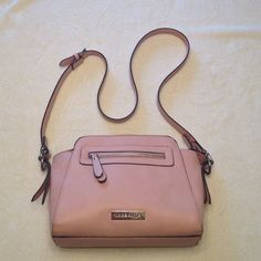 Liz Claiborne Crossbody Purse Very cute stylish and functional bag. Only carried for about a month. Great condition! Some scratches on name plate and two teeny tiny marks on the right side of the purse. Very clean inside. One inside and one outside zipper pockets. Strap measures 46 in total. Purse is 12 in across, 8 in in height and about 4 in diameter. Liz Claiborne Bags Crossbody Bags