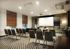 Nice use of soft colors for walls in conf. room - adds quiet tone and elegance - consider grey for creative space with punchy colorful highlights / cultural touches Room London, Soft Colors, Event Venues, Wall Colors, Melbourne, Mantra, City, Conference, Modern