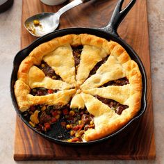 On cool nights, nothing hits the spot like a steaming homemade potpie—especially one you can get on the table fast. The pinwheel crust on top has become my signature. —Kristin Shaw, Castleton, New York Iron Skillet Recipes, Cast Iron Recipes, Skillet Meals, Skillet Pan, Skillet Cooking, Sunday Recipes, Dinner Recipes, Dinner Ideas, Fall Recipes