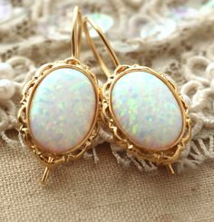 Check out this item in my Etsy shop https://www.etsy.com/il-en/listing/232821478/opal-earringswhite-opal-drop