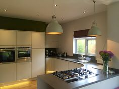 Malmo Matt Mussel with Corian worktops and OriginalBTC titan lighting