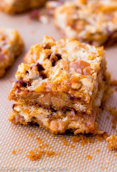 Caramel Snickers 7 Layer Bars | sallysbakingaddiction.com