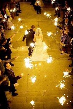 Evening wedding with sparklers instead of bubbles or rice. Gorgeous.