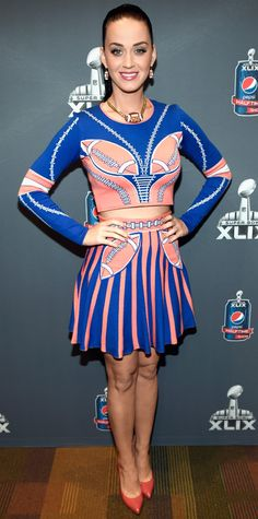 At the Super Bowl XLIX press conference, Katy Perry geared up for her halftime performance with a splashy knit RVN crop top and matching skirt woven with a custom football motif. She topped off her look with a football pendant, football earrings, and patent orange Pedro Garcia pumps.
