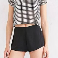NWT 6 Urban Outfitters Black Silky Tap Short 15.5in (39.25cm) across the waist, 18in (45.75cm) across the hips, 11in (28cm) rise, 1in (2.5cm) inseam, 13in (33cm) leg hole side to side, 7in (17.75cm) zipper height, 10in (25.5cm) waist to leg hole hem. Shorts are lined with a black lining.  100% Polyester Urban Outfitters Pants
