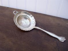 Antique Alvin tea strainer  sterling silver Raleigh 1900 pattern no monograms. $225.00, via Etsy.