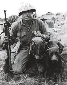 Private Francis M. Hall and Doberman, March 1945, by Marine Corps Archives & Special Collections