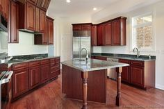 Idea of the Day: Elegant & Luxurious Cherry-Colored kitchens. Very lovely, medium wood cherry color wood hood island Kitchen Utensils Store, Kitchen Flooring, Kitchen Cabinets, Modern Kitchen, Kitchen, Wood Kitchen, Home Kitchens, Kitchen Layout, Kitchen Pictures