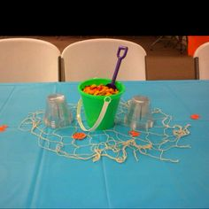 Table setting for under the sea baby shower. $1.00 pail with shovel, fill them up with Goldfish crackers :)
