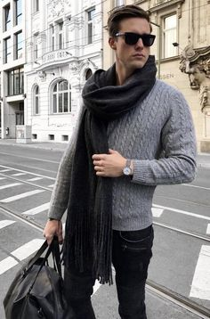 Gray cable knit sweater black scarf sunglasses black leather duffle bag  silver banded watch black sunglasses d8cba7209a2f