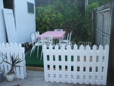 Our 50's caravan looks homely with our pallets picket fence ! Idea sent by Jason sydenham !