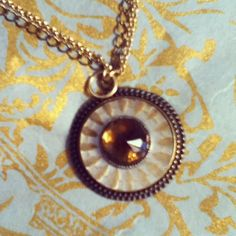 Fall is right around the corner and this antique mother of pearl and crystal button pendant will be great, worn long or short.