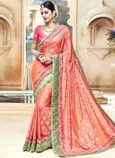 Buy saree and designer saree online. Order this lively embroidered, patch border and resham work traditional designer saree for wedding.