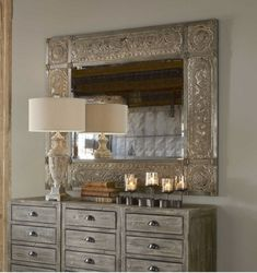 Looking to add a single luxury statement to your Rough Luxe style? Designed by Carolyn Kinder International, this ornate frame features heavily distressed, golden champagne leaf with black undertones, deep red dry brushing and a heavy, rusty tan wash. Mirror has a generous 1 1/4″ bevel.